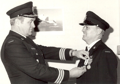 LCol. R.L.Hughes presents the Jubilee Medal to WO R.J. Beard.